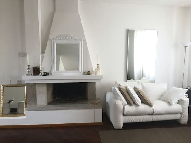summer living room and fireplace white & sand