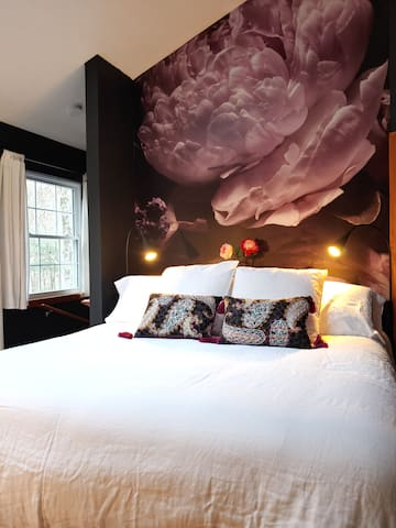 Zero gravity bed (reclining with massage). This bedroom is beautiful and romantic. Gas log fireplace with remote control.