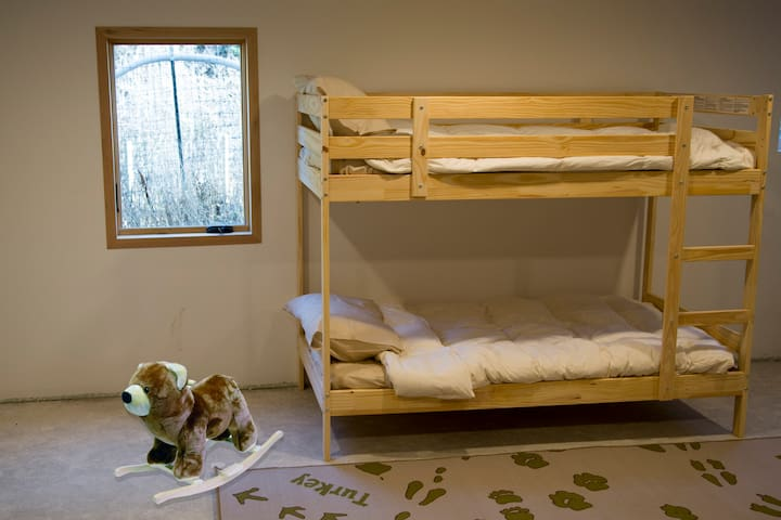 The basement has a bunk bed and will be outfitted with plenty of board games!