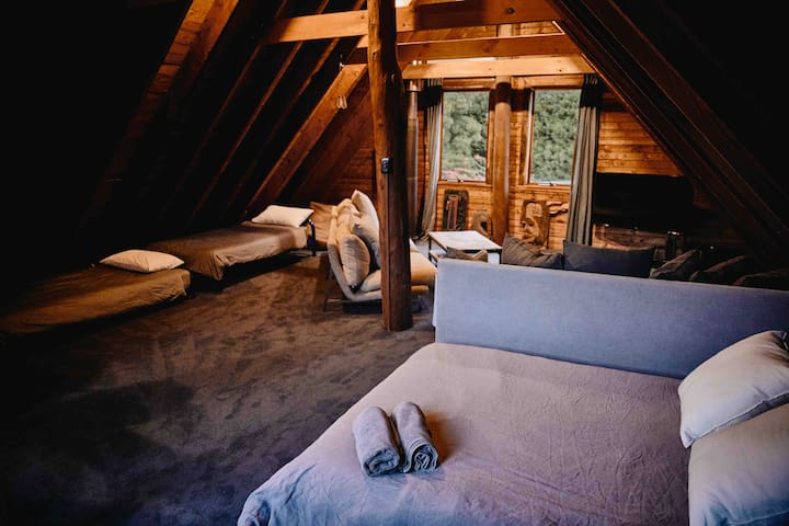The loft upstairs, which can be set up with extra beds when you book for 10+ people.