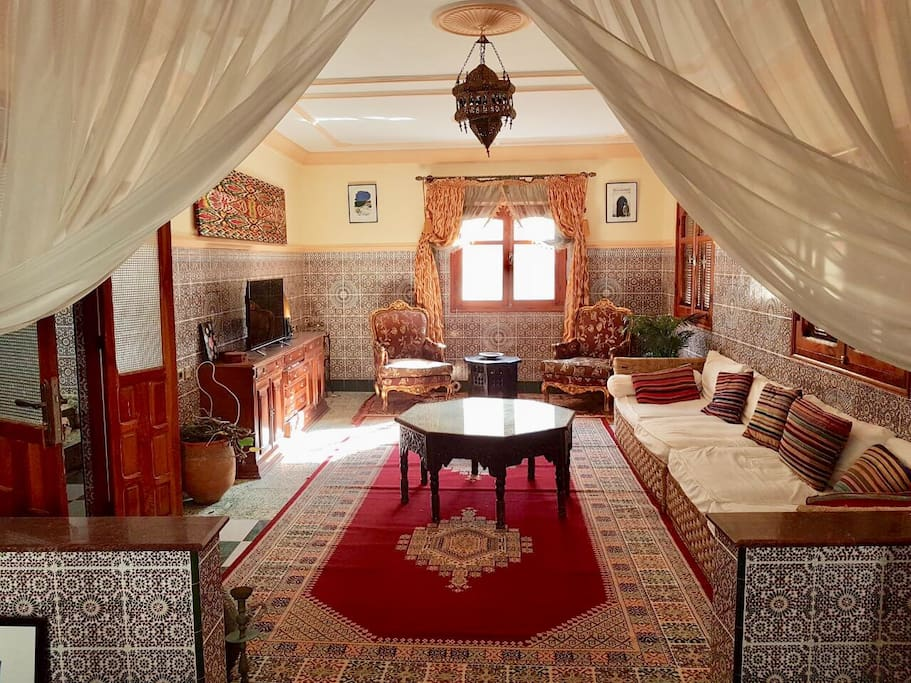 "Living room...HUGE...& decorated in Moroccan "" medina style"