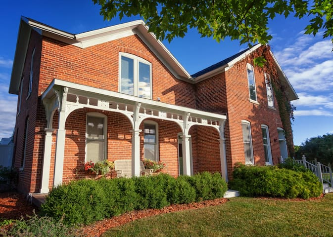 Charming Brick Farmhouse with a Touch of Elegance