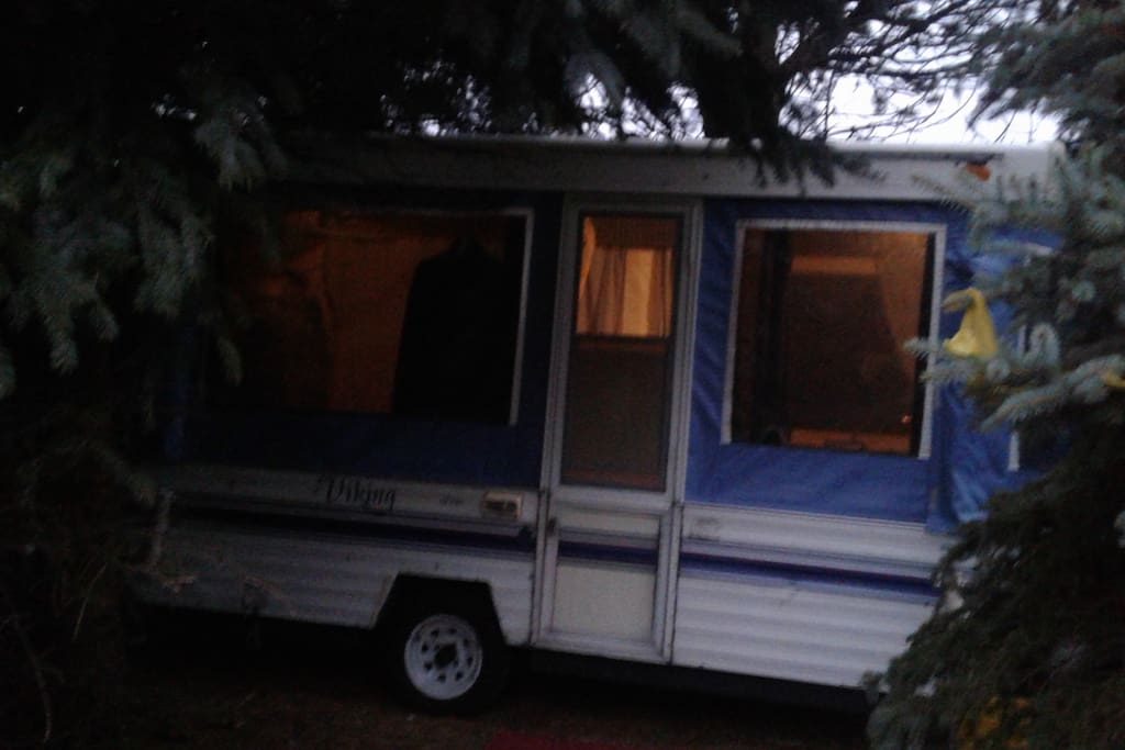 The Camper at night with tinted windows & curtains open