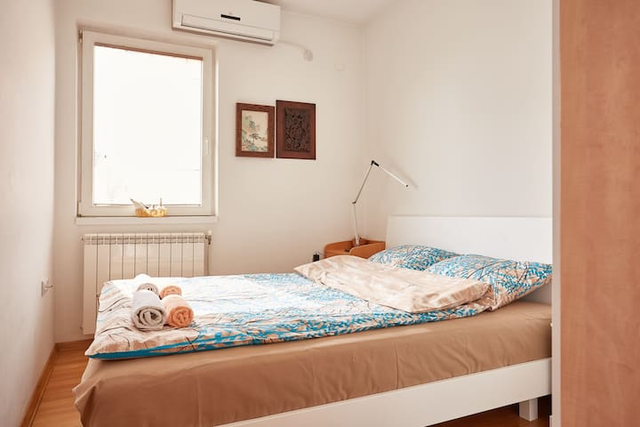The queen size bed to dream away in after a day of fun or work in Skopje.