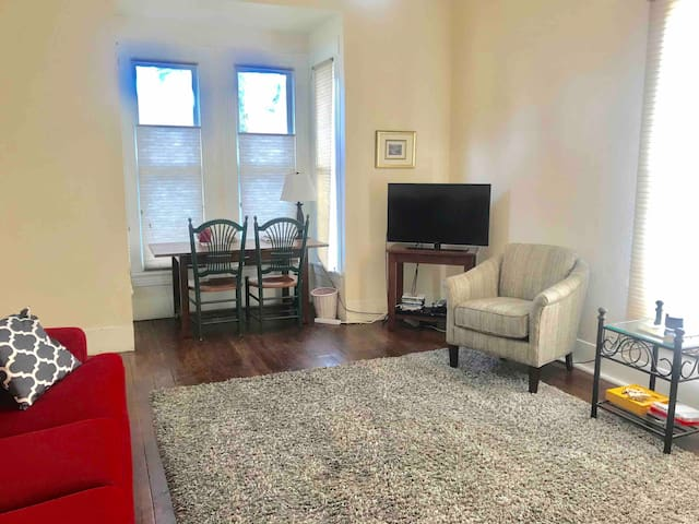 There is a TV, sofa, chair, Queen Murphy bed and desk/chairs  in the LIving Room, which is the largest room in the Julia Rose. Make this your bedroom and you will have lots of room!