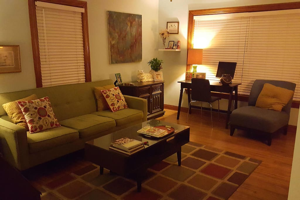 """Comfortably sized living room with couch, desk, stereo, 32"""" TV, DVD player and Wii (not pictured, to the right across from couch.) Can accommodate a queen-sized air mattress."""