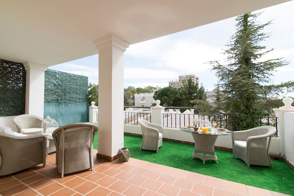 Large sunny terrace, with lounge and outdoor dining area.