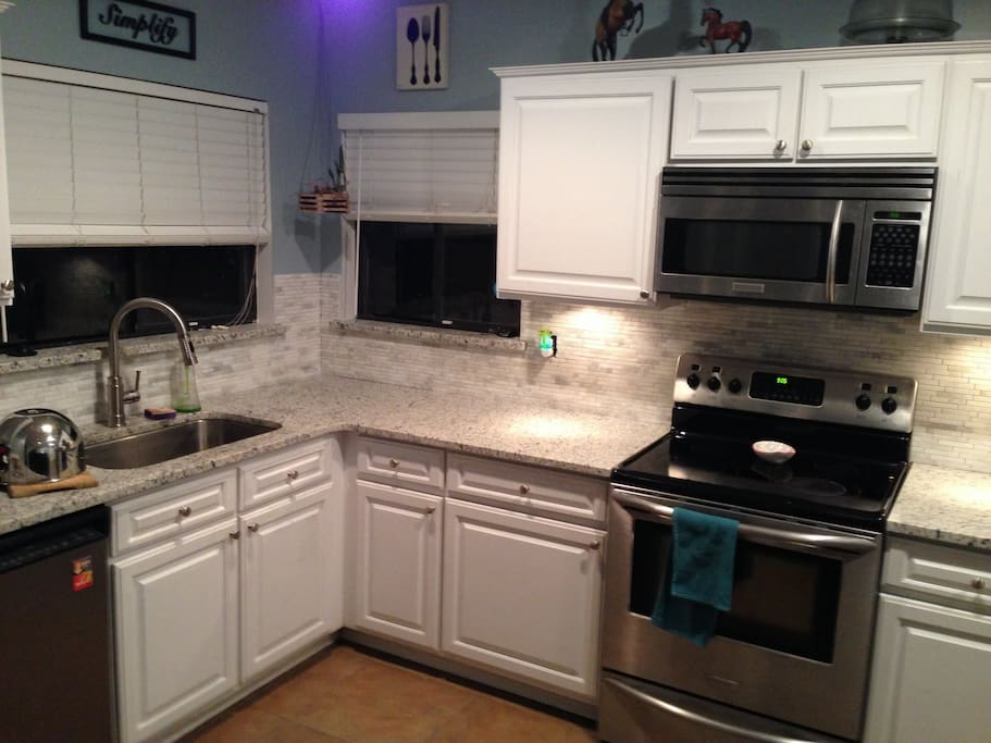 Clean bright Beautiful Kitchen with Sparkling Granite