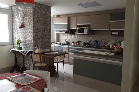 Apartamento praia grande -3 quartos - Torres - Byt