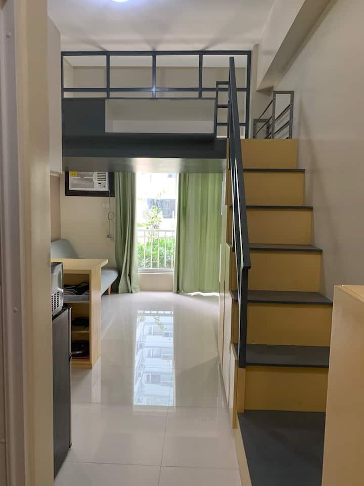 Studio condo with a loft