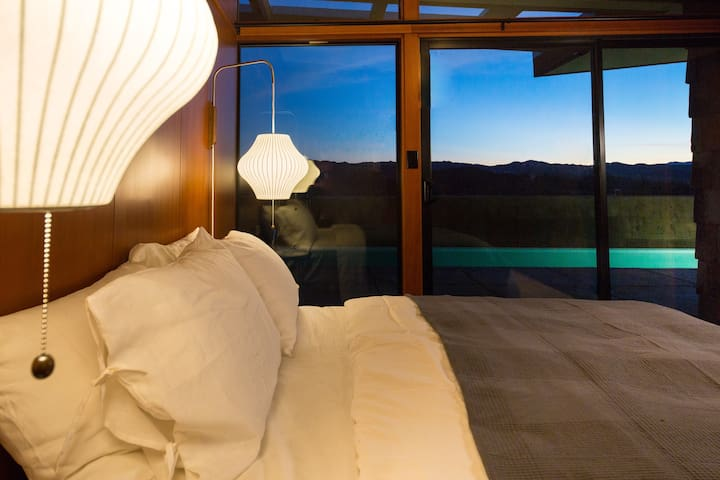 Sleep tight on this super comfortable bed, mountains are outside the window.