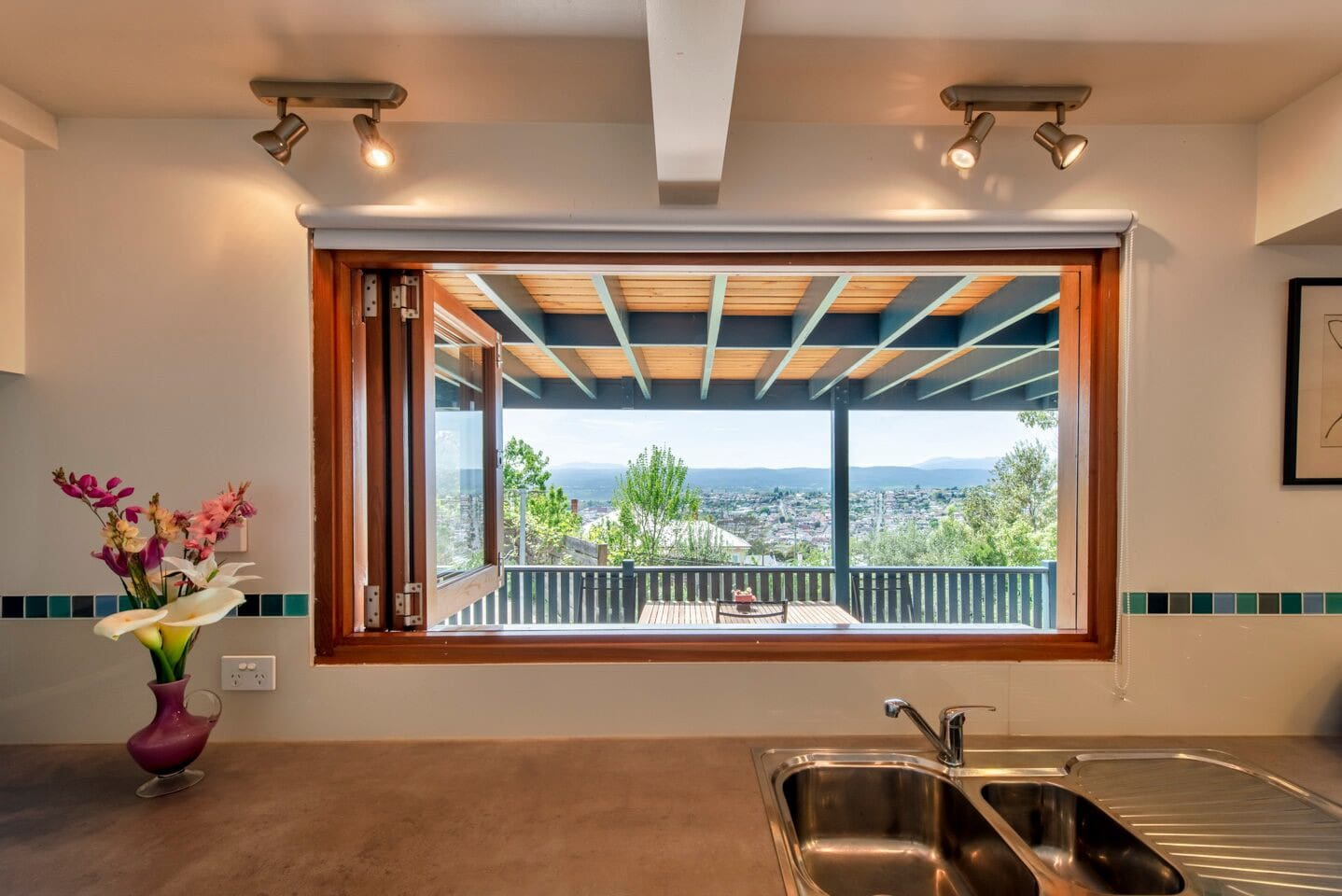 Enjoy the city and mountain views whilst preparing meals in the fully equipped kitchen with bifold windows.