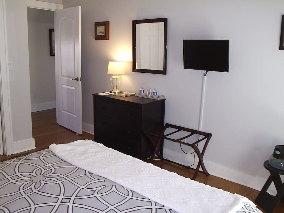 The room has such amenities as a Smart TV, 3-drawer dresser, full-length mirror on the back of the door, large closet, and luggage rack.