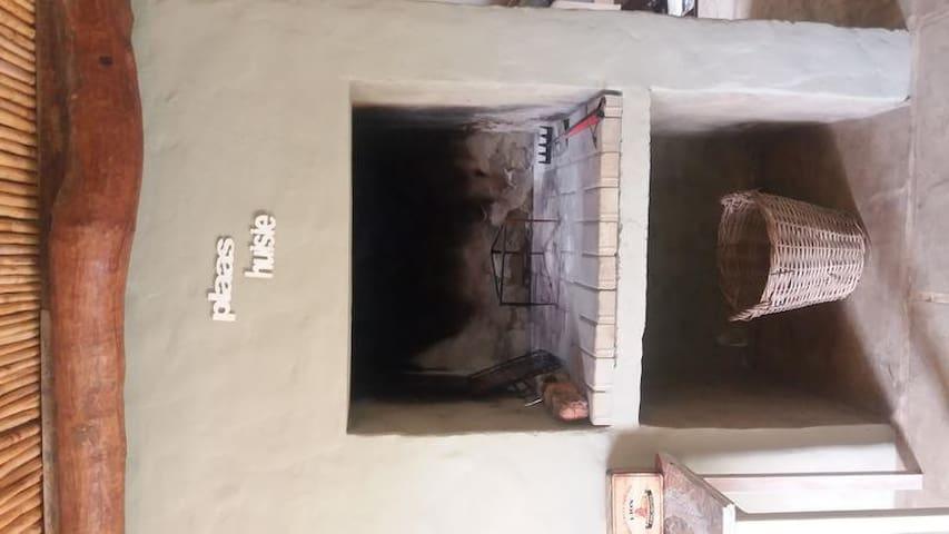 Die Plaashuisie:One-Bedroom House ,fireplace photo 1