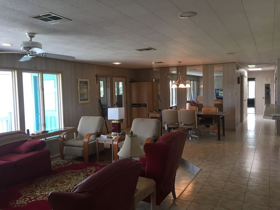 A Shot of the Living  Room and Hallway Leading To Bathroom and Bedrooms. A very comfortable living and dining room that is spacious and comfortable