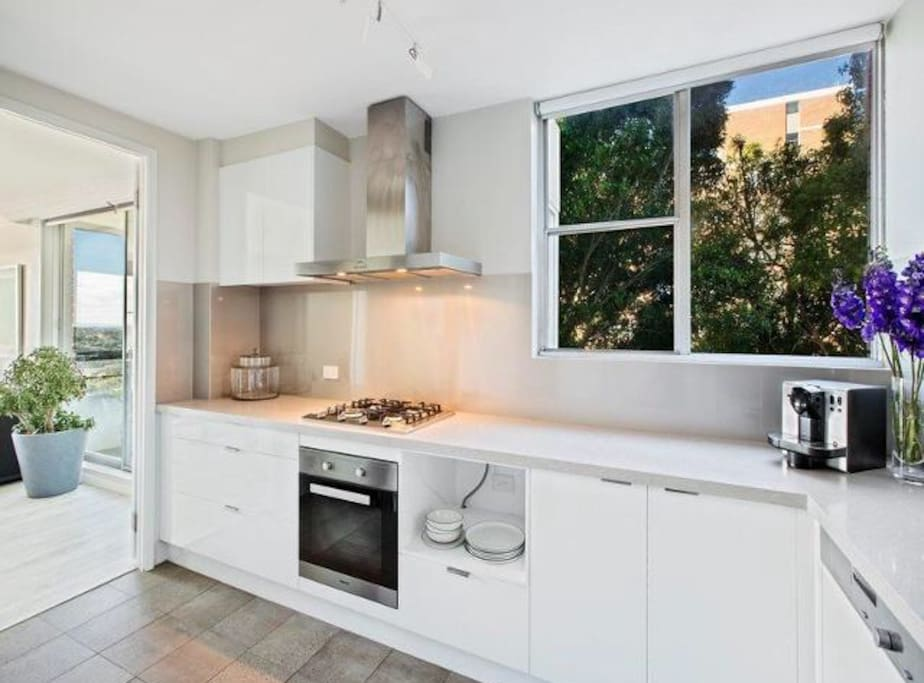 Modern, clean, spacious kitchen with Miele products, Nespresso coffee machine and anything else you need