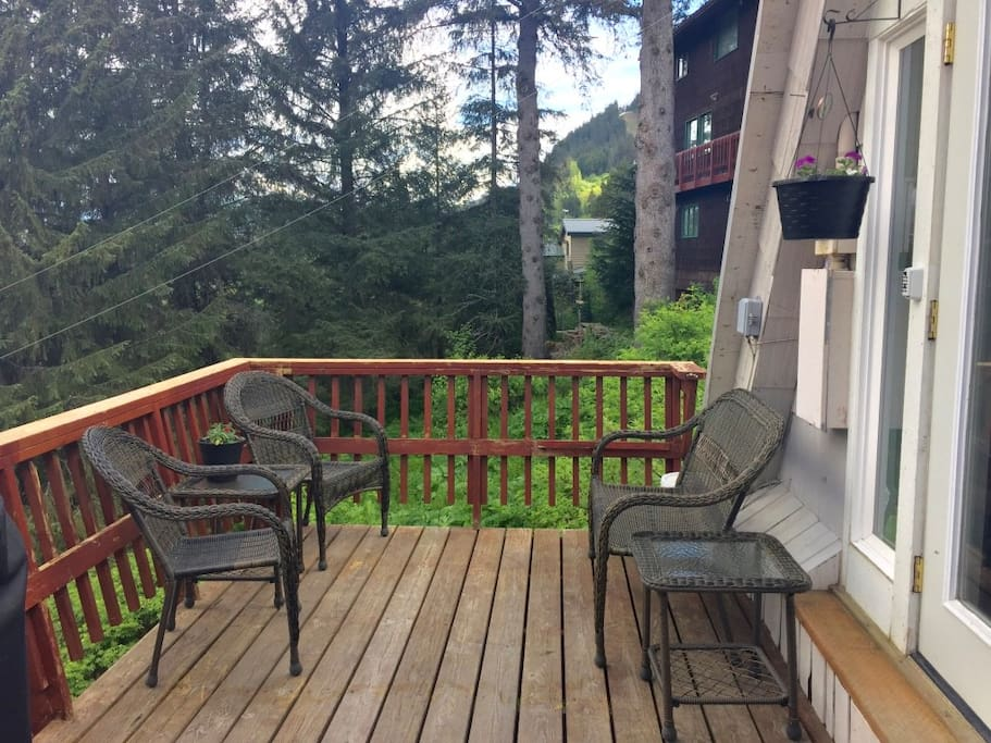 Deck at the front of the house with sitting area