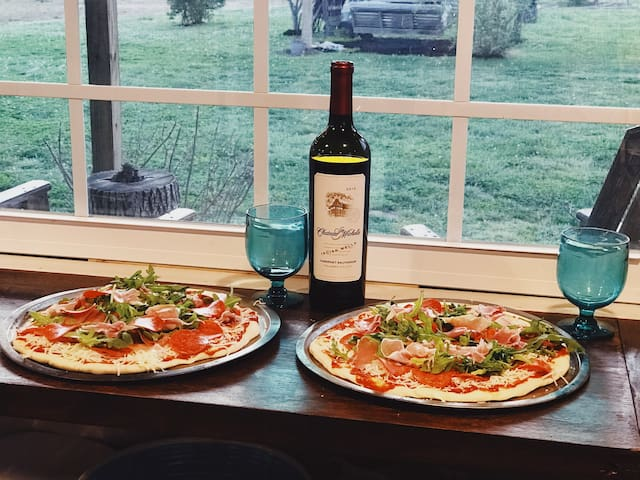 Guest photo of their pizza before cooking them in the wood fire oven
