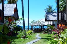 Follow the winding path from our back gate through our resort to the beach in front