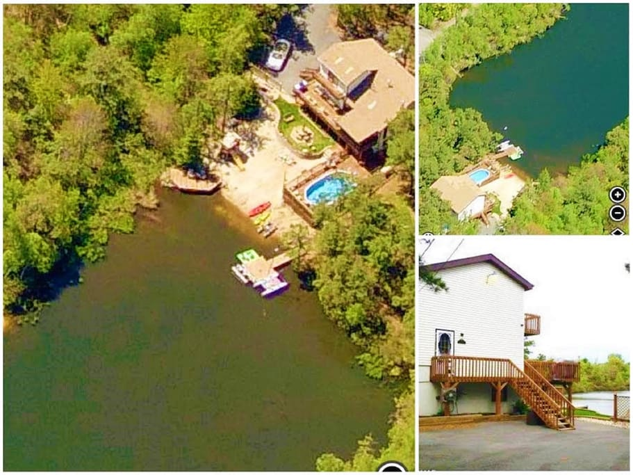 Satellite view of house, sandy beach, pool, 2 docks, play set, picnic table, and a large paved drive way. Pedal boat, boat, kayaks, life vests, oars available.