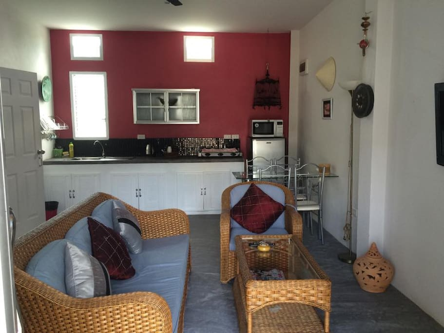 """living room with 32"""" flat screen and kitchenette"""