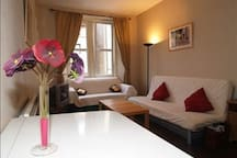 The lounge is bright and fresh and has a double sofa bed