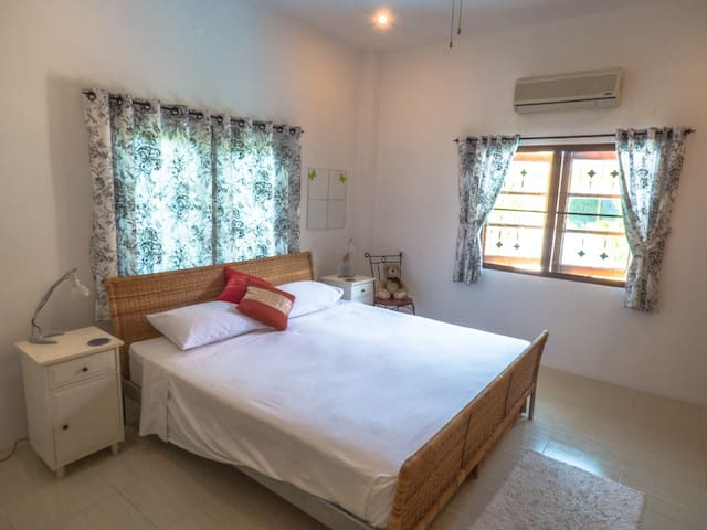 Master bedroom with ceiling fan and air conditioning