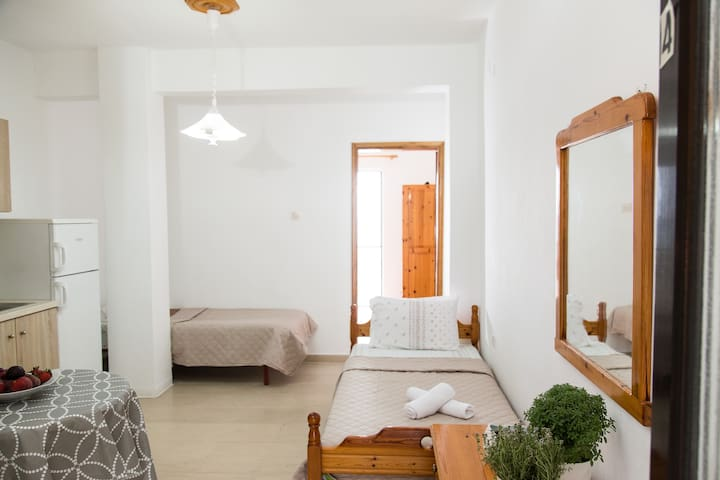 living room with 2 single beds and kitchen,in front is the main bedroom with sea view