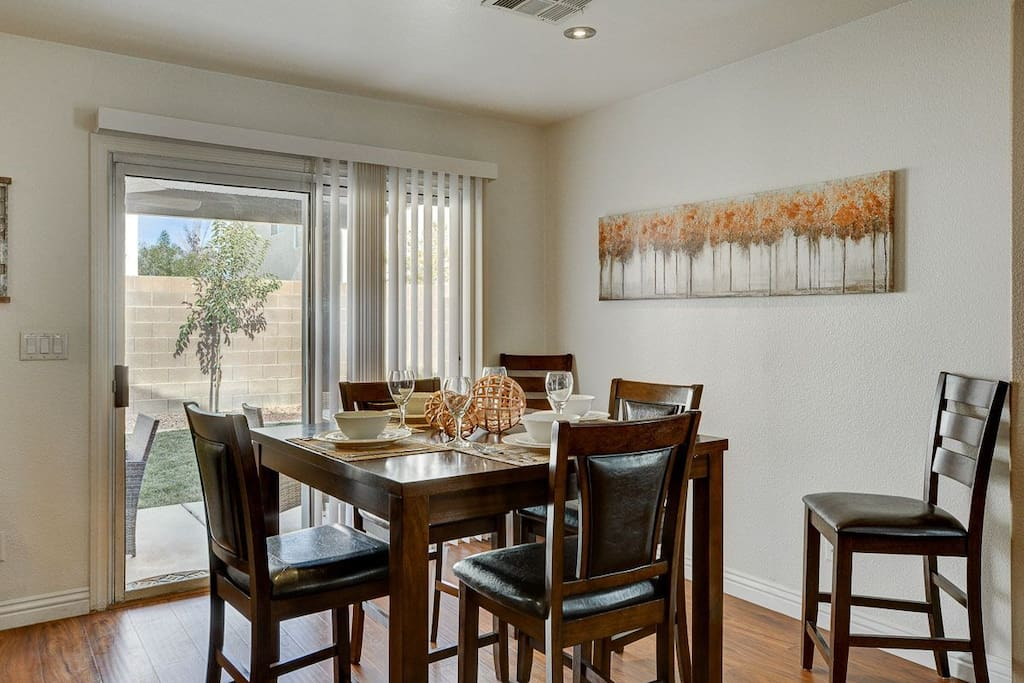 Dining room area with a lovely view of the backyard.
