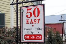 Sports bar and grille is a three minute walk.