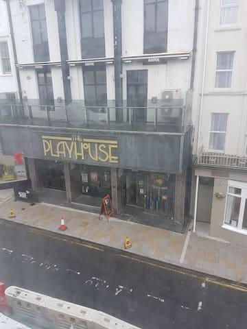 Kiwi Bar and Playhouse across the street