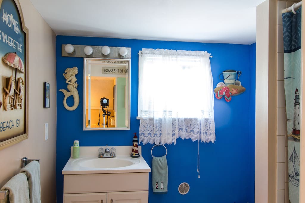 A bright and sunny bathroom with a pop of color!