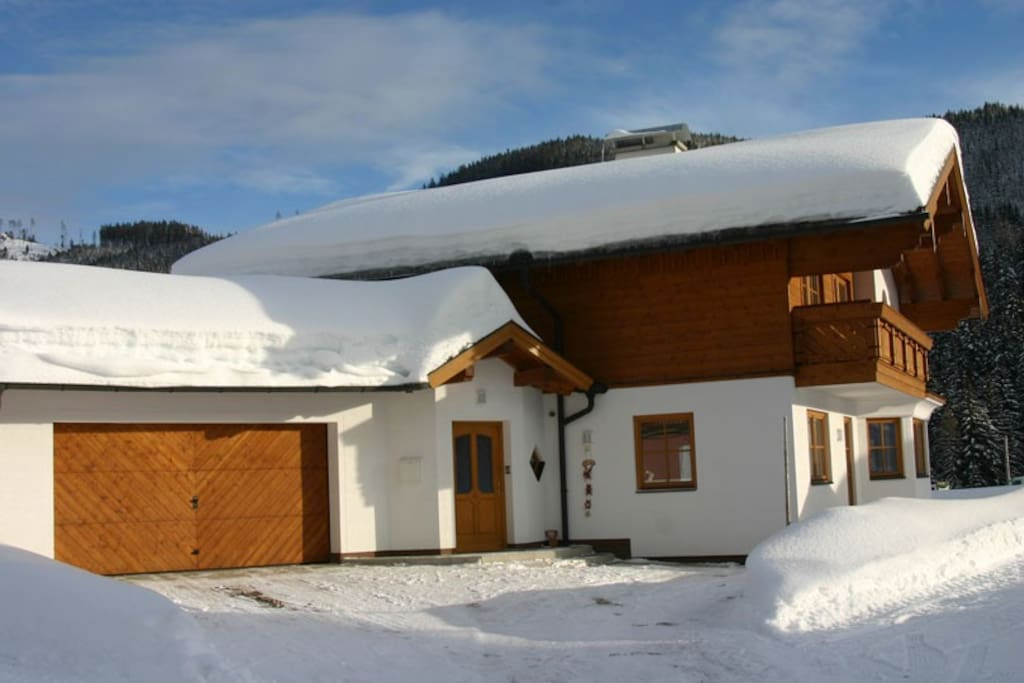 View of the front of the chalet after a heavy snowfall in Ski Amade near Salzburg.