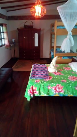 Second floor suit with hammocks ,bed sofa, table and chairs. The room has Ocean, pool, garden view. Hot/Cold shower and private bathroom. The room is for 2- 6 people