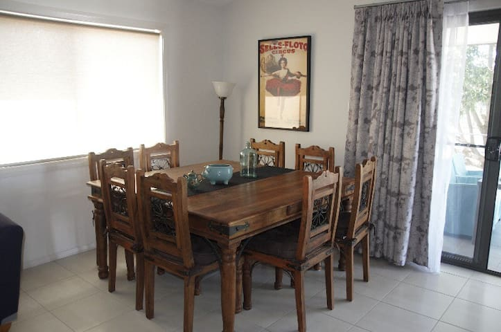 Dining room features setting for 8 people