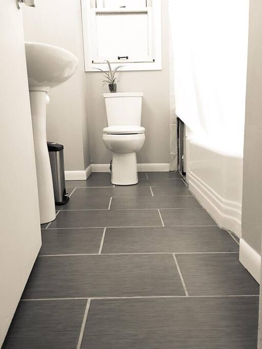 Recently remodeled bathroom with heated tiles.
