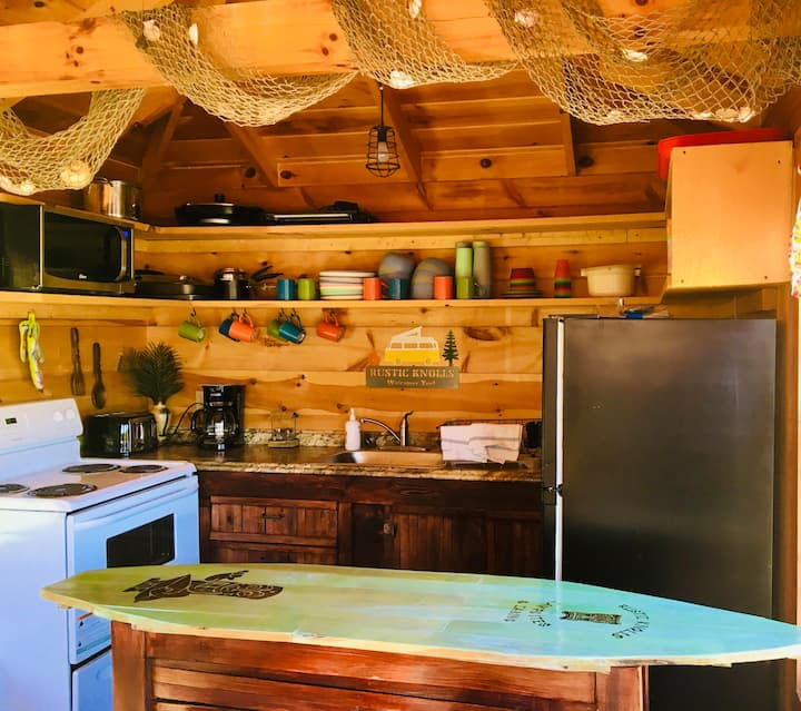 Kitchen : Full Stove, Fridge, Microwave, and other appliances.