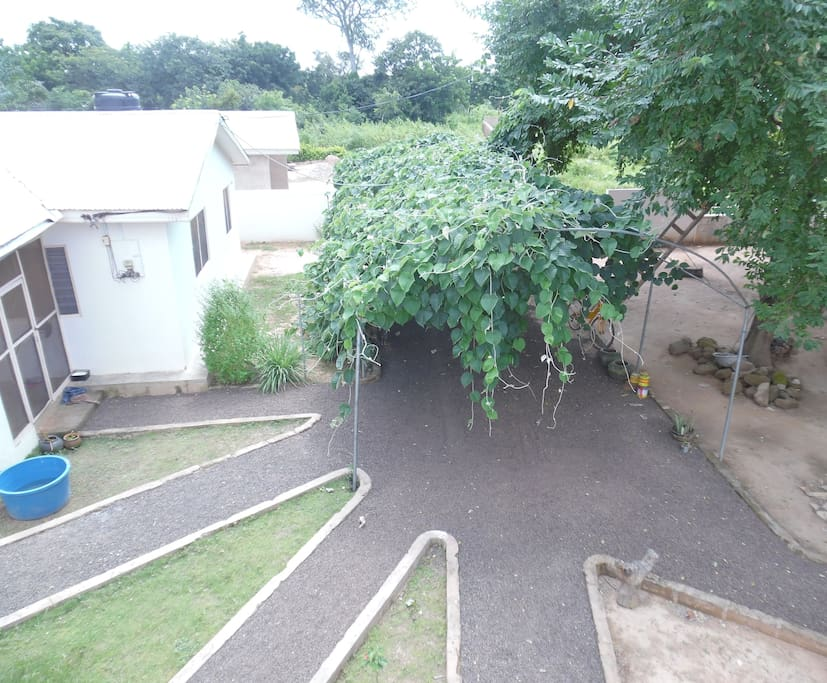 Top view; left is our family house, the paths lead to  two guest rooms, an office / kitchen space, and a gazebo.