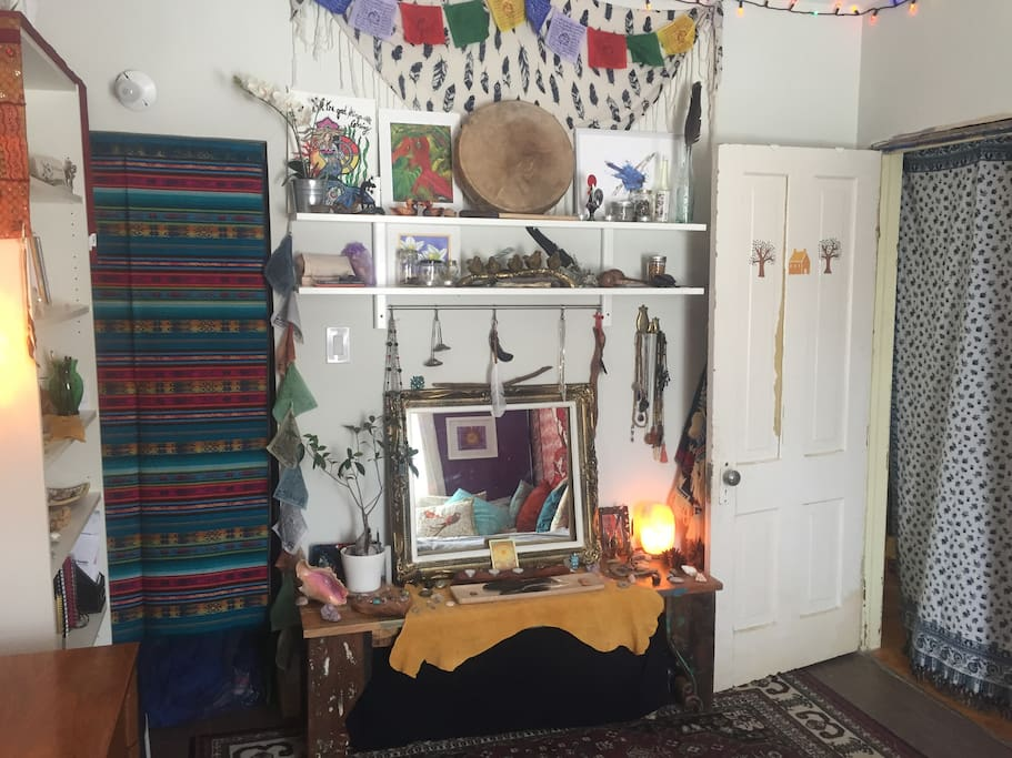 Beautiful altar space of the owner of the room. Surround yourself with medicines and sacred objects from around the world.