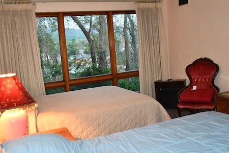 Two queen beds with overlooking big window view.