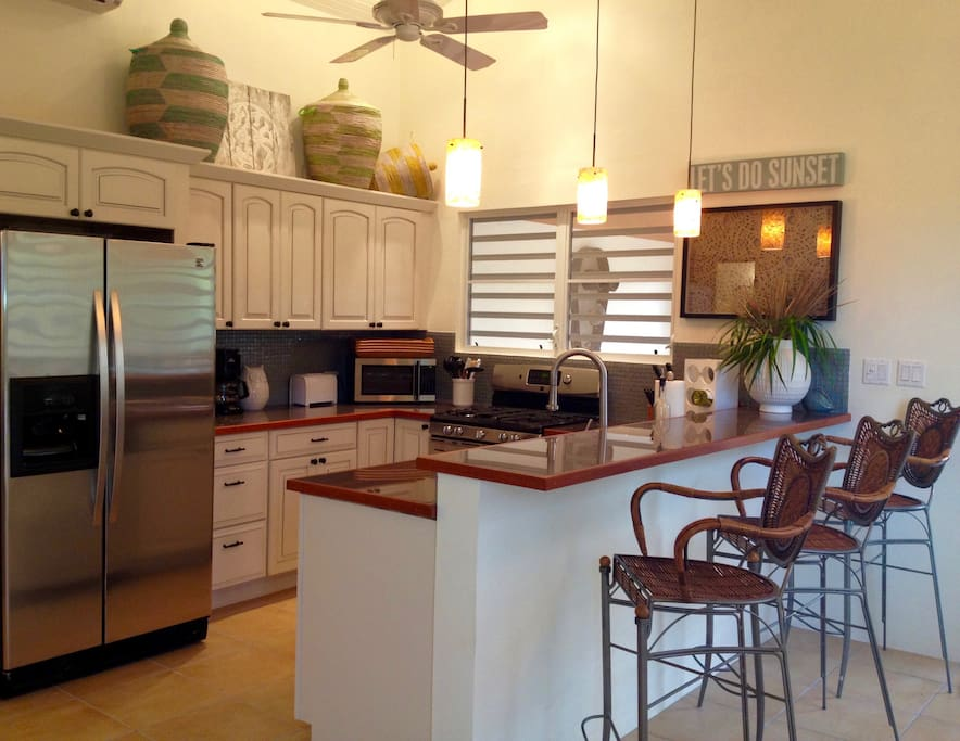 Kitchen and Bar Area with Gas Stove and Dishwasher