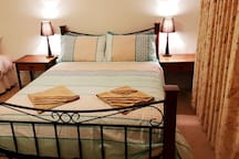 Super comfy bed with fresh linen with additional rollaway trundle (available in the cupboards)
