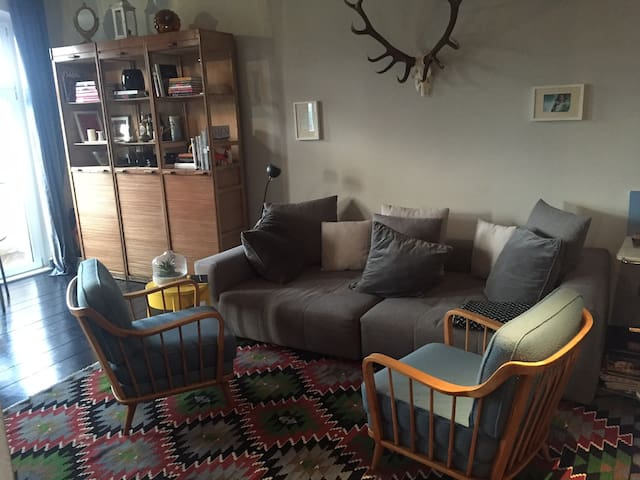 Eclectic, light flooded apt for 2