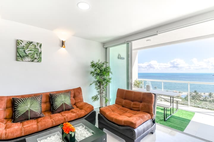 Beachfront apartment w/ garden and ocean views, WiFi, partial AC & shared pool!