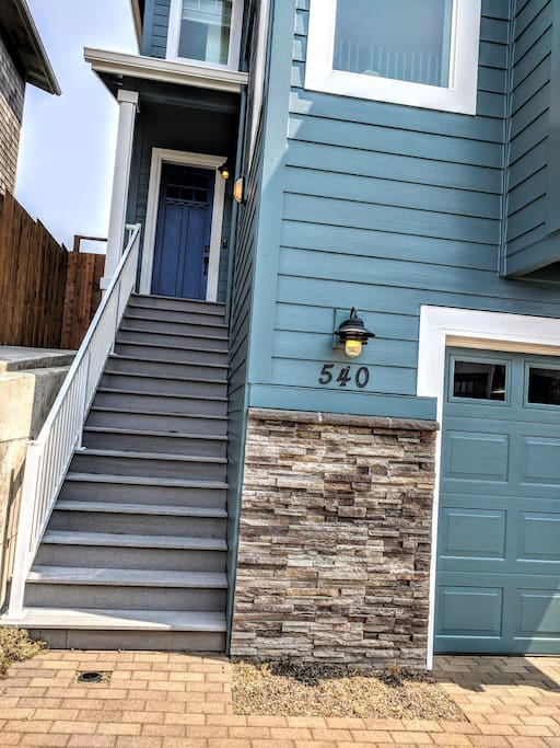 Well lit front entrance with Schlage code lock for easy and safe access