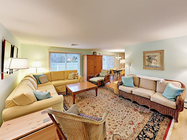 Gather around the coffee table for a game night in the spacious living room.