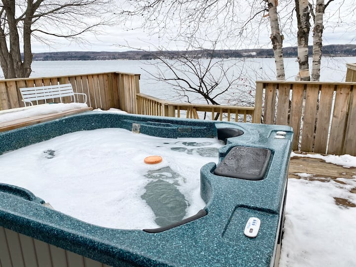 Relax in the hot tub overlooking Munising Bay