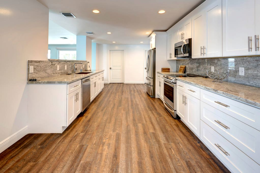 Brand new bright kitchen with stainless steel appliances and granite counters!