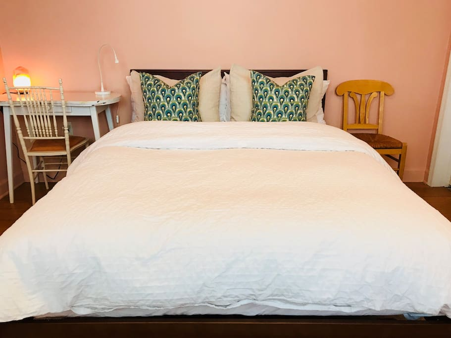 Queen bed with fresh linens, down comforter, and fluffy pillows