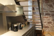 Kitchen with kettle and coffee machine